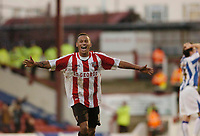 Photo: Leigh Quinnell.<br /> Brentford v Huddersfield Town. Coca Cola League 1. 21/01/2006. Dudley Campbell celebrates his goal for Brentford.