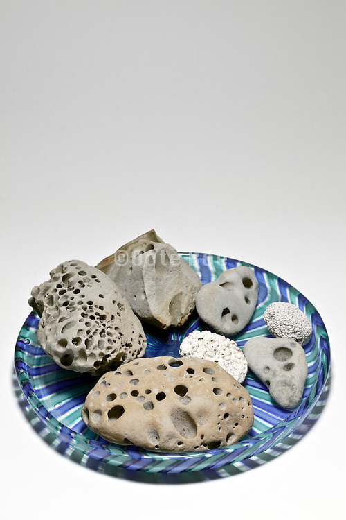 perforated stones on a decorative glass plate
