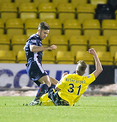 Falkirk's Kieran Duffie tackles  Livingston Shaun Rutherford, gets a yellow card<br /> Livingston 0 v 1 Falkirk, Scottish Championship played13/12/2014 at The Energy Assets Arena.