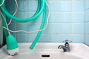 small bathroom sink with hose a electric water pump and faucet