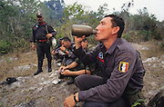 RAINFOREST FIRES DEFORESTATION, Amazon, near Boavista, northern Brazil, South America. Brazilian firemen taking a break from beating forest fires. Ecological biosphere and fragile ecosystem where flora and fauna, and native lifestyles are threatened by progress and development. The rainforest is home to many plants and animals who are endangered or facing extinction. This region is home to indigenous primitive and tribal peoples including the Yanomami and Macuxi.