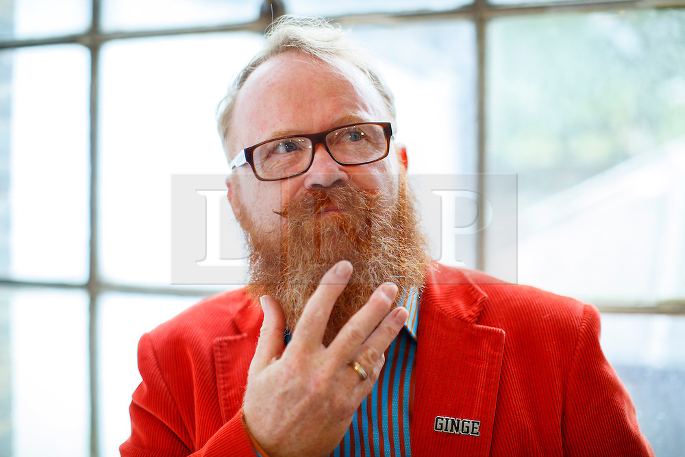 © Licensed to London News Pictures. 17/09/2016. London, UK. Ron Hind poses with his ginger beard a hundreds of redheads attend Redhead Day UK event in Angel, London on Saturday, 17 September 2016. Natural redhead visitors get chance to celebrate their ginger genes and shop specialised products, see ginger related exhibitions and live performances. Photo credit: Tolga Akmen/LNP