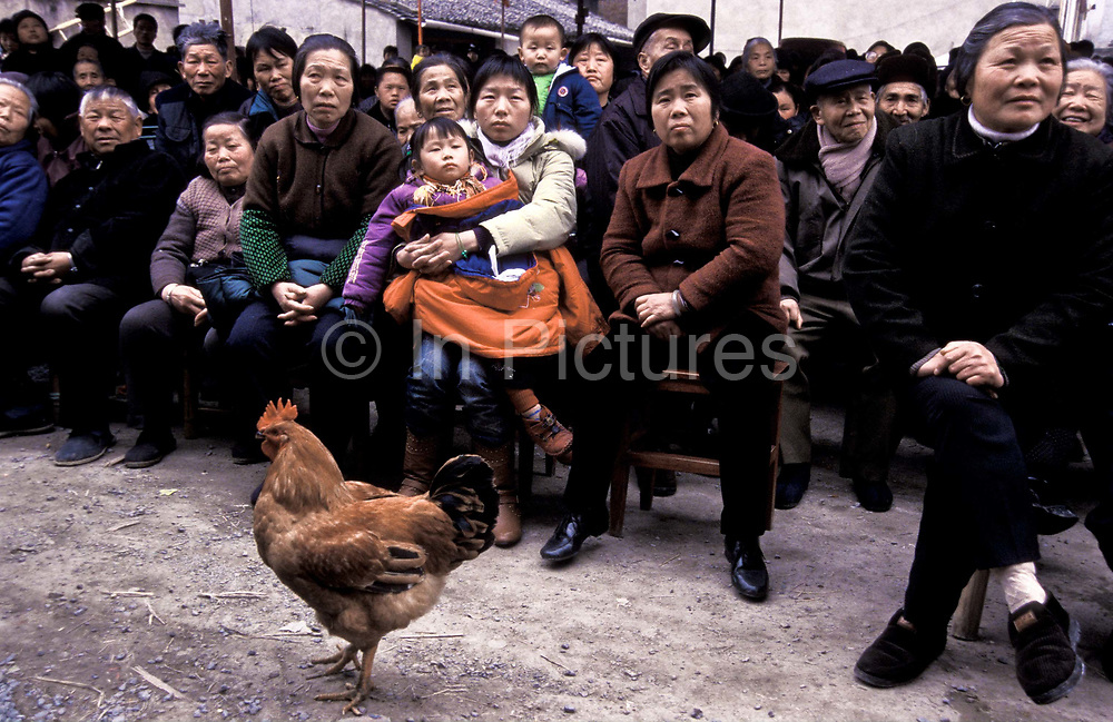 A  Yue Opera's audience in a farming village close to Shaoxing city, ZheJiang province