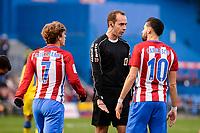 Atletico de Madrid Antoine Griezmann and Yannick Carrasco talking with the referee during La Liga match between Atletico de Madrid and UD Las Palmas at Vicente Calderon Stadium in Madrid, Spain. December 17, 2016. (ALTERPHOTOS/BorjaB.Hojas)