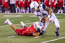 NORMAL, IL - September 04: Bret Bushka works trying to escape the grasp of Cade Campos, but Campos forces a fumble which it later recovered by the Bulldogs during a college football game between the Bulldogs of Butler University and the ISU (Illinois State University) Redbirds on September 04 2021 at Hancock Stadium in Normal, IL. (Photo by Alan Look)