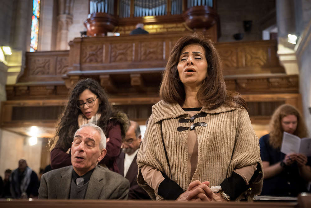 1 March 2020, Bethlehem: People pray during Sunday service in the Evangelical Lutheran Christmas Church in Bethlehem.