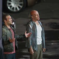 Australian actor Jai Courtney (L) and US actor Bruce Willis (R) play in a fight schene on set during a shooting of their next movie fifth in the Die Hard series titled Good Day to Die Hard in Budapest, Hungary on July 11, 2012. ATTILA VOLGYI