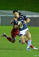 Conwy, UK. Friday, 15 November 2013<br /> Pictured: Akihito Yamada of Japan is tackled by Alexey Makovetskiy of Russia<br /> Re: Japan v Russia rugby at Parc Eirias, Conwy, North Wales, United Kingdom.