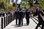 Riot squad police are seen during the Melbourne Freedom Rally at Parliament House. Police move into position on the steps of state parliament ahead of a planed protest. The groups who have organised the many Freedom Day protests over the last 3 months, attempted to march on State Parliament during Melbourne Cup Day demanding the sacking of Premier Daniel Andrews for the lockdown and attacks on their civil liberties. Police met with the protester's with significant force despite the city having had zero cases for five days. (Photo by Dave Hewison/Speed Media)