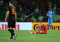 Football - European Championships 2012 - Portugal vs. Netherlands<br /> Christiano Ronaldo of Portugal celebrates at the final whistle following his teams win as Robin Van Persie of the Netherlands leaves the field dejected as his team go out of the competition at the Metalist Stadium, Kharkiv, Ukraine
