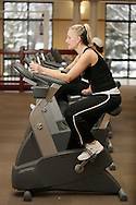 Rachel Taylor uses an exercise bike at the Middletown YMCA on Monday, Dec. 7, 2009.