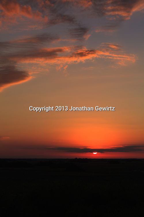 The sun sets over sawgrass prarie in the Shark Valley section of Everglades National Park, Florida. WATERMARKS WILL NOT APPEAR ON PRINTS OR LICENSED IMAGES.