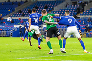 Birmingham City's Harlee Dean (12) holds on to Cardiff City's Robert Glatzel (9) during the EFL Sky Bet Championship match between Cardiff City and Birmingham City at the Cardiff City Stadium, Cardiff, Wales on 16 December 2020.