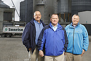 SHOT 10/29/18 9:47:50 AM - Sunrise Cooperative is a leading agricultural and energy cooperative based in Fremont, Ohio with members spanning from the Ohio River to Lake Erie. Sunrise is 100-percent farmer-owned and was formed through the merger of Trupointe Cooperative and Sunrise Cooperative on September 1, 2016. Photographed at the Clyde, Ohio grain elevator was George D. Secor President / CEO and John Lowry<br /> Chairman of the Board of Directors with  CoBank RM Gary Weidenborner. (Photo by Marc Piscotty © 2018)