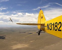 A glider releases from the tow plane