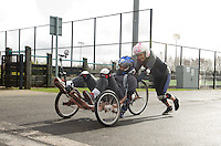 Blue Peter presenters have gone head-to-head on their personally modified bikes in a cycle race for Sport Relief 2014.  Lindsey Russell helps Radzi Chinyanganya over the finish line<br /> <br /> Photo by Chris Vaughan/CameraSport<br /> <br /> Commercial - Sport Relief -  publicity shoot - Tuesday 4th March 2014 - University of Central Lancashire Sports Arena - Preston<br /> <br /> © CameraSport - 43 Linden Ave. Countesthorpe. Leicester. England. LE8 5PG - Tel: +44 (0) 116 277 4147 - admin@camerasport.com - www.camerasport.com