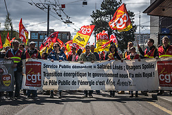 April 13, 2018 - Lyon, France - Protesters hold a banner and wave union flags as French rail workers demonstrate on April 13, 2018 in Lyon, eastern France. French rail workers launched their latest two-day strike over plans to overhaul the national state-owned railway company SNCF. The rolling rail strikes, set to last until June 28, are being seen as the biggest challenge yet to the President's sweeping plans to shake up France and make it more competitive. (Credit Image: © Nicolas Liponne/NurPhoto via ZUMA Press)