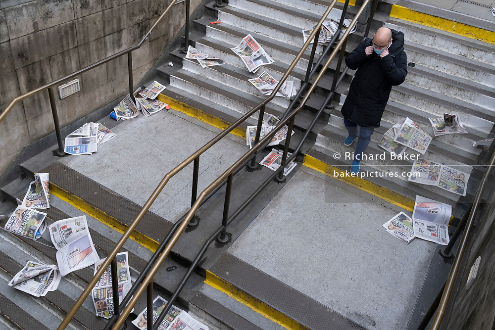 As Londoners are told to remain at home and therefore few commuters taking newspapers for their homeward journeys, copies of the Evening Standard blow down the steps of Bank Underground station during the third lockdown of the Coronavirus pandemic, in the 'City of London', the capital's financial district, aka The Square Mile, on 2nd February 2021, in London, England.