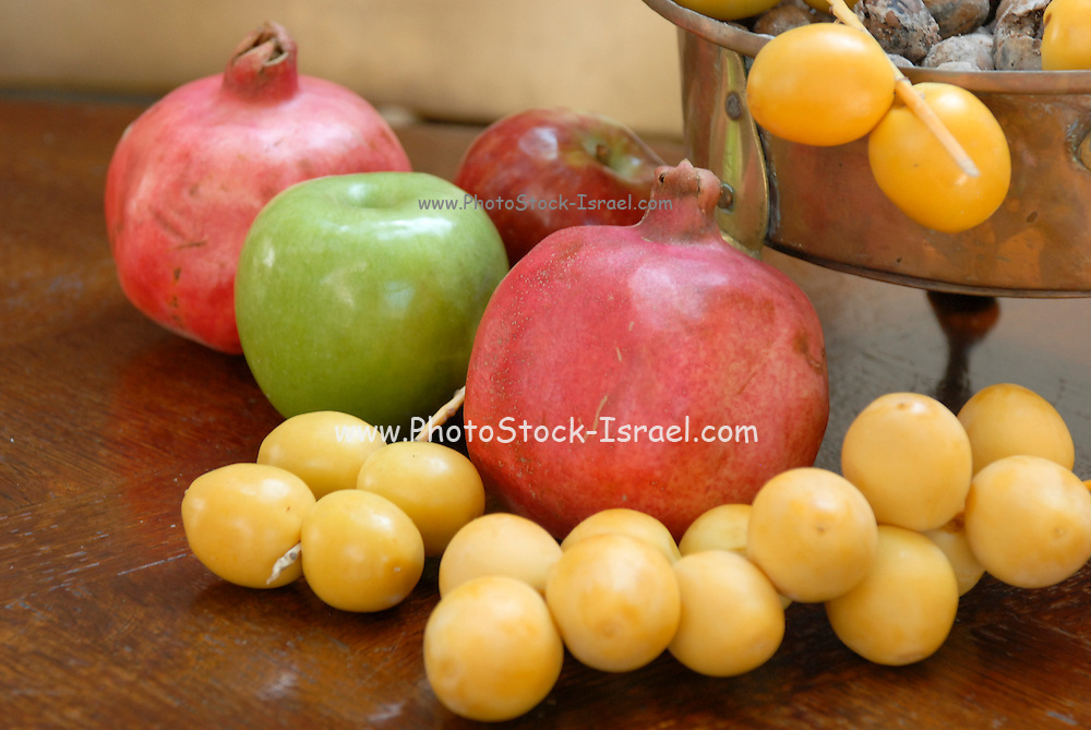 apple, dates, and pomegranate traditionally eaten on the Jewish Rosh Hashana Feast to insure a sweet and round (complete) year to come