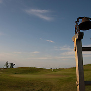 The Erin Hills Golf Course, a rolling and rugged course in Erin, Wisconsin, is home to the 2017 US Open, is well known for the par 3, 7th hole, a green hidden between two slopes. Once play is concluded, a bell is rung to announce the green is open. Please send licensing requests to legal@toddbigelowphotography.com Please send licensing requests to legal@toddbigelowphotography.com