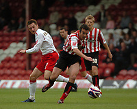 Photo: Tony Oudot.<br /> Brentford v Lincoln City. Coca Cola League 2. 27/10/2007.<br /> Kevin O'Connor of Brentford goes past Lee Frecklington of Lincoln