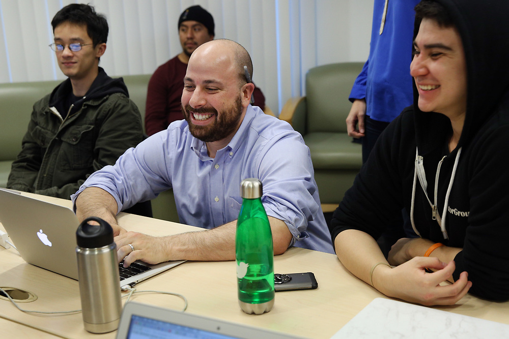 Caleb Jonas (center) teaches Christian Salas (right) and Anthony Khieu (left) on Thursday, Nov. 2, 2017, in San Francisco, Calif. The nonprofit Samaschool is helping job seekers learn about gig economy work.