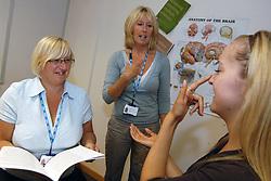 Multiple scleroris nurses demonstrate a test for co-ordination