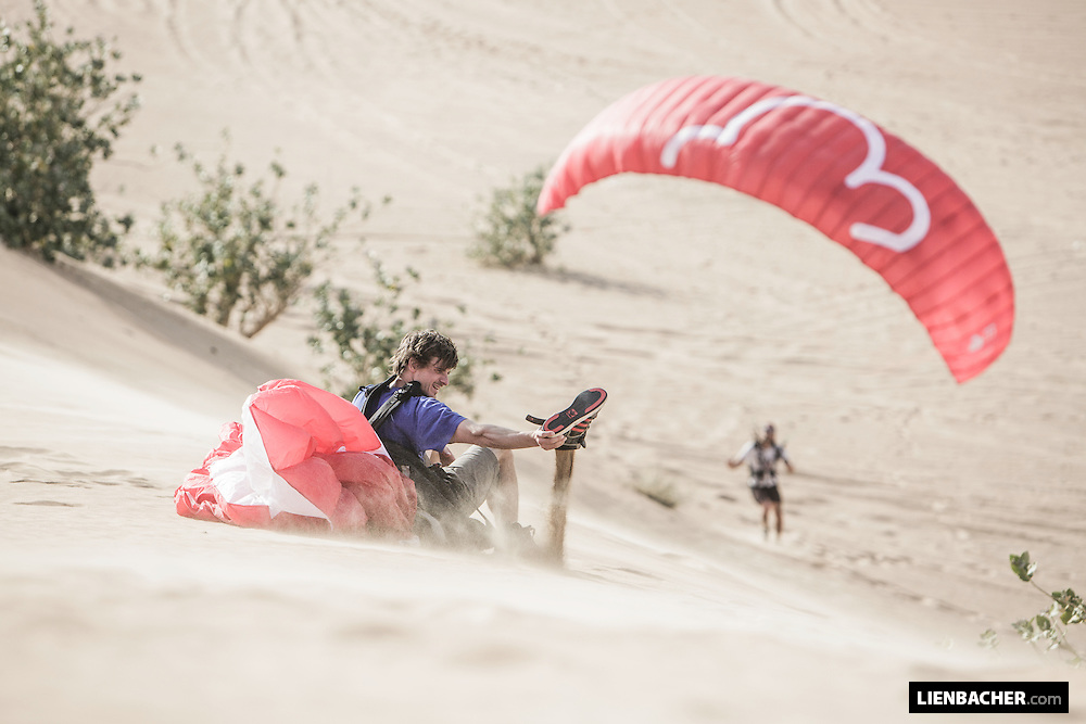 Dominic Roithmair has a break soaring his little cloud on a dune in Dubai. March 2015