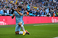 Sergio Aguero of Manchester city celebrates after he scores his teams 1st goal. The Emirates FA Cup semi-final match, Arsenal v Manchester city at Wembley Stadium in London on Sunday 23rd April 2017.<br /> pic by Andrew Orchard,  Andrew Orchard sports photography.