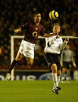 Photo: Chris Ratcliffe.<br />Arsenal v Sparta Prague. UEFA Champions League.<br />02/11/2005.<br />Matthieu Flamini (L) of Arsenal gets Zelenka of Prague