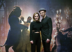 Emma Watson and Dan Stevens during a photo call with the cast of Beauty and the Beast, at The Corinthia Hotel, London.