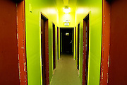 View down a brightly painted hallway of rental creative spaces and  rehearsal studios in Seattle, Washington.