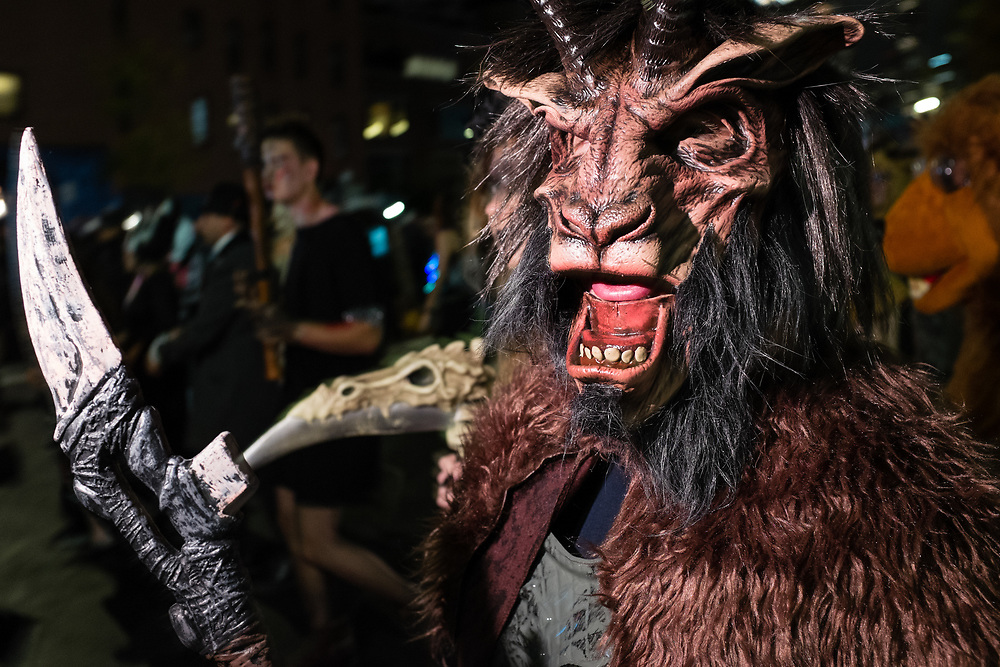 New York, NY - 31 October 2019. the annual Greenwich Village Halloween Parade along Manhattan's 6th Avenue. A reveler in a hairy costume of a horned beast.