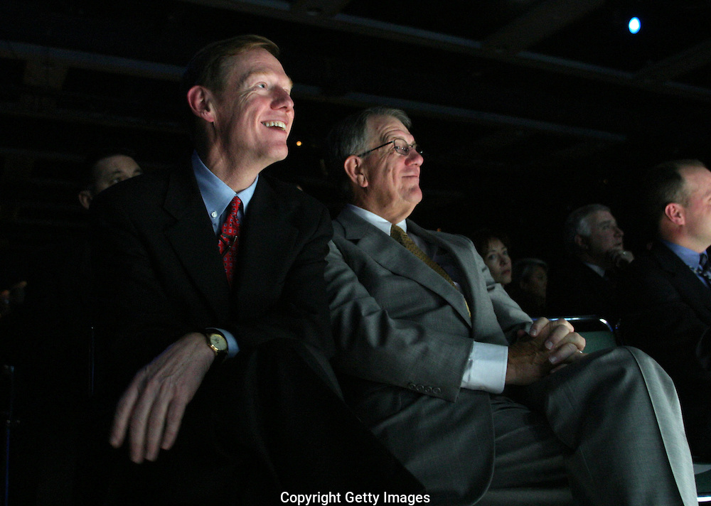 Alan Mulally, then President and CEO of Boeing commericial Airplanes, left, and former Boeing CEO Harry Stonecipher, right, listen from thier seats during an announcement of the Dreamliner 787 airplane. (John Froschauer /Getty Images)