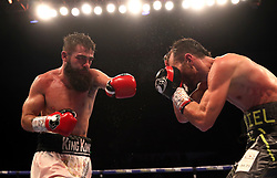 Jono Carroll (left) and Guillaume Frenois in action during the Final Eliminator for IBF Super-Featherweight Champioship at the FlyDSA Arena, Sheffield.