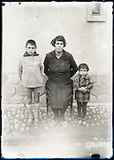 eroding glass plate photo of mother with two children