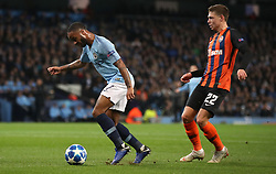 Manchester City's Raheem Sterling (left) goes down in penalty area under pressure from Shakhtar Donetsk's Mykola Matviyenko which results in a penalty kick