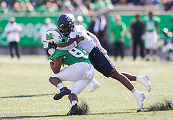 Oct 9, 2021; Huntington, West Virginia, USA; Old Dominion Monarchs linebacker Ryan Henry (8) tackles Marshall Thundering Herd tight end Devin Miller (83) during the third quarter at Joan C. Edwards Stadium. Mandatory Credit: Ben Queen-USA TODAY Sports