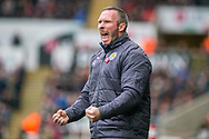 caretaker Manager of Leicester City, Michael Appleton celebrates and reacts to Leicester's second Goal. Premier league match, Swansea city v Leicester city at the Liberty Stadium in Swansea, South Wales on Saturday 21st October 2017.<br /> pic by Aled Llywelyn, Andrew Orchard sports photography.