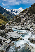 Snowy Creek and Mt Edward on the descent from Rees Saddle to Dart Hut on the Rees-Dart Track in Mount Aspiring National Park, Otago region, South Island of New Zealand. Glacier-clad Mt Edward rises above.