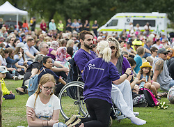 March 23, 2019 - Christchurch, Canterbury, New Zealand - A March for Love to unite the community in the wake of a terrorist attack on two city mosques that left 50 people dead attracts several thousand people, including 21-year-old MUSTAFA BOZTAS who was shot and wounded in the attack at the Al Noor mosque. The march, from Hagley Park to the Botanic Gardens, was organized by three teenagers. (Credit Image: © PJ Heller/ZUMA Wire)