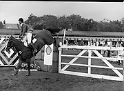 Shell Sponsored Events At The Dublin Horse Show.(R39).1986..07.08.1986..08.07.1986..7th August 1986..At the Horse Show Shell sponsored both the Speed and Power competition and The Puissance..The Speed and Power event was won by Hap Hanson riding 'Gambrinus'. The Puissance was shared by Capt John Ledingham (Irl) on 'Kilcoltrim' and Nick Skelton (GB) on 'Raffles Apollo' who both cleared the high wall at 7feet...Image shows Peter Weinberg (GER) on 'Pirol' taking part in the Speed and power event.
