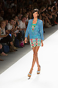 Print shorts, matching strapless top, and lace jacket. By Custo Barcelona at the Spring 2013 Fashion Week show in New York.