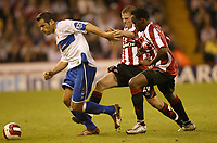 Photo: Aidan Ellis.<br /> Sheffield United v Middlesbrough. The Barclays Premiership. 30/09/2006.<br /> Boro's Mark Viduka looks to get away from Sheffield defender's Claude Davis and Chris Armstrong