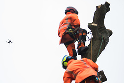 A drone is used to monitor the felling by tree surgeons working with the National Eviction Team on behalf of HS2 Ltd of a 200-year-old oak tree alongside the East West Rail route known locally as the '7 Sisters Oak' as part of works connected to the HS2 high-speed rail link on 23 September 2020 in Steeple Claydon, United Kingdom. A small group of local people and anti-HS2 activists based at the nearby Poors Piece Conservation Project also observed the felling of the tree, which was home to bats and other species, whilst monitored by a joint force of around fifty bailiffs, security guards and police officers from Thames Valley Police.