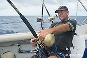 skipper Steve Campbell fights a fish on his charter vessel Reel Addiction, off Hunga Island, Vava'u, Kingdom of Tonga, South Pacific