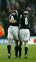 Photo. Andrew Unwin.<br /> Southampton v Newcastle United, FA Cup Third Round, Friends Provident St Marys Stadium, Southampton 03/01/2004.<br /> Newcastle captain Alan Shearer (l) congratulates his teammate, Kieron Dyer (r), on scoring the game's first goal.