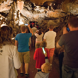 October 5, 2013- Luray, Virginia- Inside Luray Caverns visitors listen to the guide describe the process of creating the rock formations inside the cave. Since it's discovery in 1878 by a tinsmith and a local photographer, visitors by the millions have made Luray Caverns the most popular cave in Eastern America.<br />  <br /> 4,000,000 centuries in the making beneath Virginia's storied Shenandoah Valley, the surrounding stalactite formations cover more than three acres.