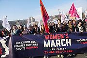 January, 21st, 2017 - Paris, Ile-de-France, France: Women march with 'Les Droits des femmes sont des droits humains' banner. Thousands of protesters in Paris join anti-Trump Women's March around the world.