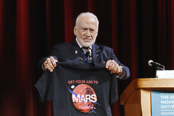 """Gemini XII & Apollo XI astronaut Buzz Aldrin holds a T-Shirt """"Get your ass to Mars""""during the Humans 2 Mars Summit at the George Washington University in Washington, DC, on May 9, 2017. Photo by Olivier Douliery/ Abaca"""